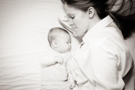 sleeping: co-sleeping mother and baby Stock Photo