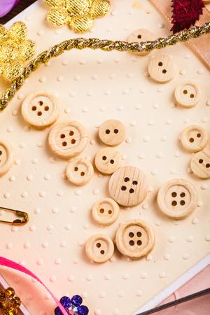 craft materials: Scrapbooking craft materials for decorating postcards - woden buttons