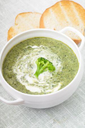 broccolli: Brocolli cream soup in a white bowl