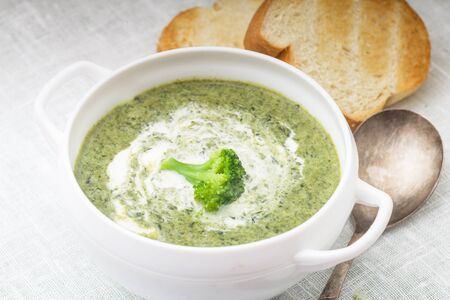 brocolli: Brocolli cream soup in a white bowl