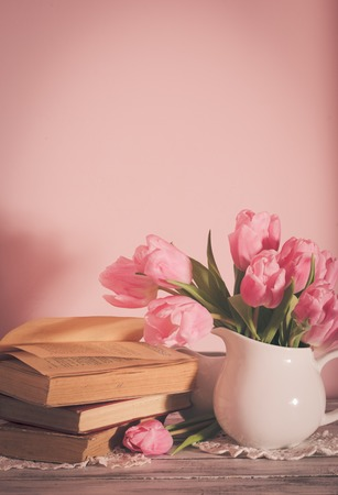 poem: Poem still life with books and pink tulips Stock Photo