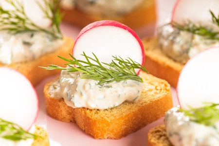 canapes: canapes with cream cheese pasta with dill and radish