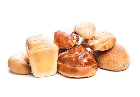 Different types of breads and buns isolated on white photo