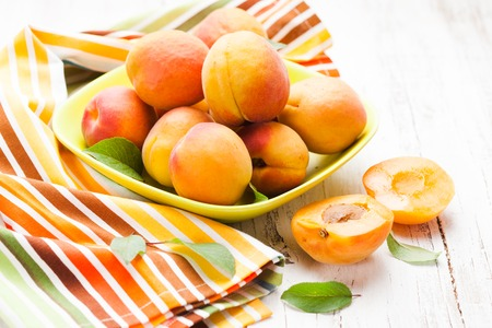 fleshy: Fleshy apricots in the bowl on the table Stock Photo