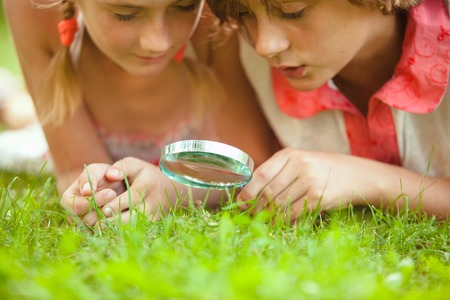 Kids with magnifying glass