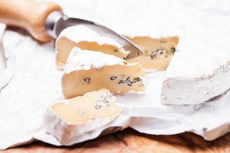 unpacked: Cheese cut into two mold Stock Photo