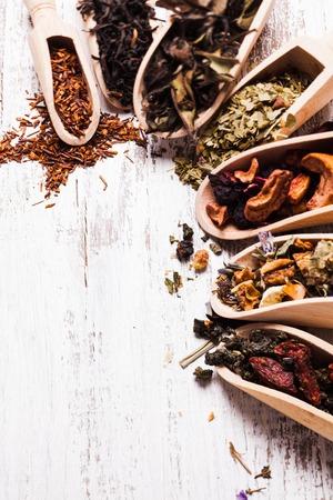 Various of tea in wooden scoops