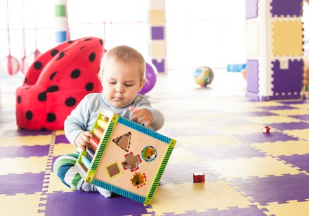 motility: Boy plays with toy cube