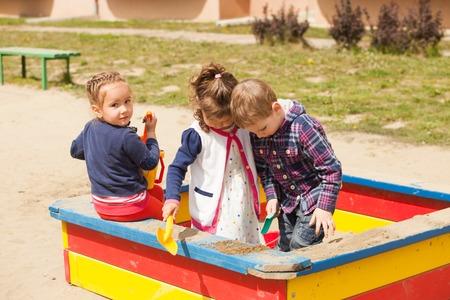 sandbox: kids playing in the sandbox
