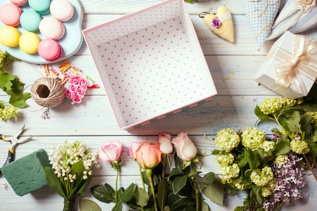 Box with flowers and macaroons photo