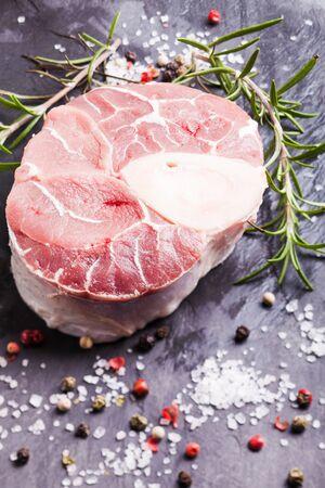 cross cut: Raw fresh slice of meat - cross cut veal shank on a slate board