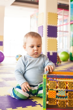 motility: Boy plays with cube