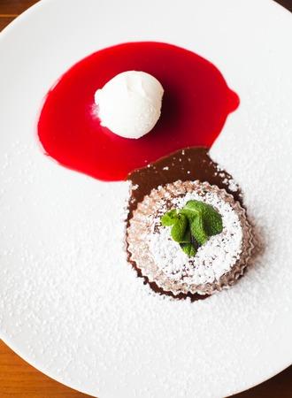 sause: Chocolate fondant with berry sause and vanilla ice cream Stock Photo
