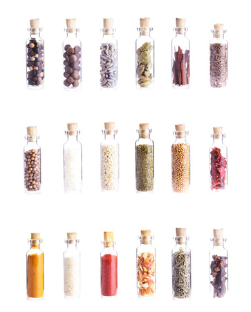Mini bottles with spices isolated on white. Set of eighteen objects Stock Photo