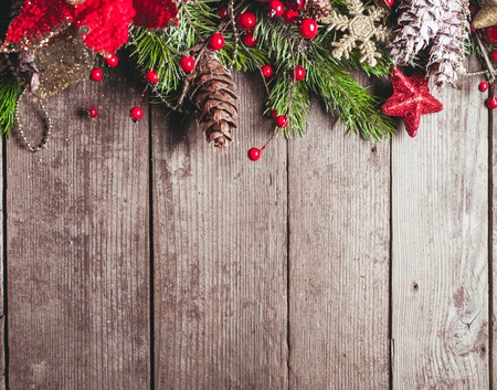 pine green: Christmas border design on the wooden background Stock Photo