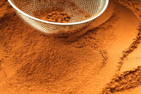 chocolate powder: chocolate powder and sieve, prepared for cooking