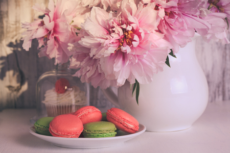 crema: Lovely cakes and macaroons with coffee and flowers