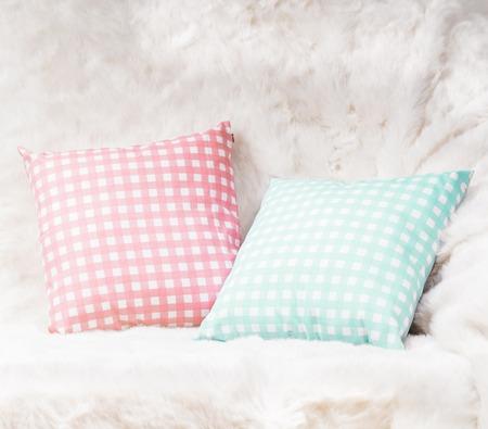 white sofa: Pillows on the sofa with white fur Stock Photo