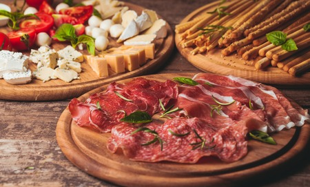 Italian appetizer - various types of ham, cheese and grissini Stockfoto