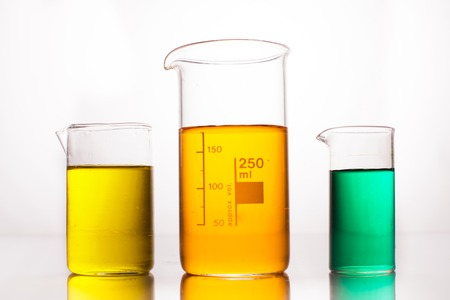 liquid: Measuring Beaker with color liquids on a white