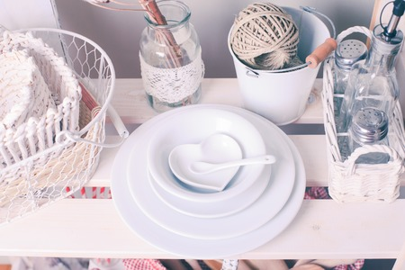 chic: Lovely homeware and dishware in the kitchen at shabby chic style Stock Photo