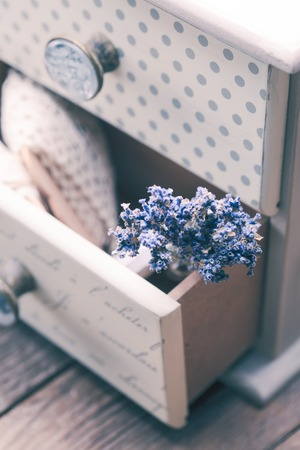 old furniture: Bunch of dry lavender in decorative little shabby chic chest of drawers