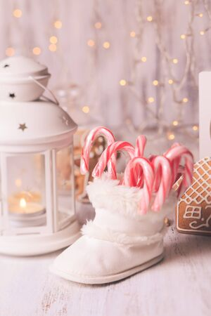 christmas decor: Holiday candies - Santa stuffs in white bootie, Christmas decor