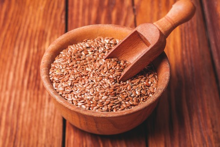 organic flax seed: The flax seeds in a wooden bowl close up