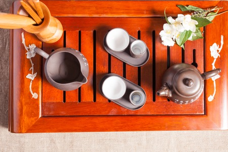 chinese tea ceremony: Chinese tea ceremony - close up traditional crockery Stock Photo