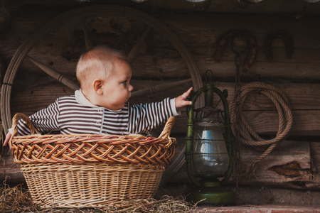 granary: Rural retro still life. Table near the granary and adorable baby boy
