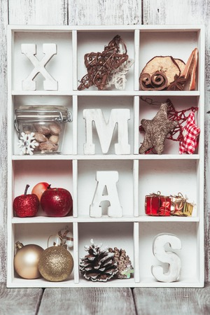 shadow box: Christmas decoration in a wooden box. Cozy holiday in home. Wood letters XMAS in shadow box memories Stock Photo