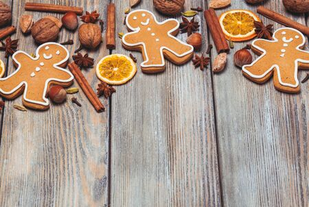 holiday cookies: Gingerbreads with spices on the wooden table