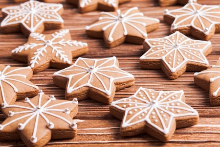 gingerbread cookies: Gingerbread star cookies on a wooden background.