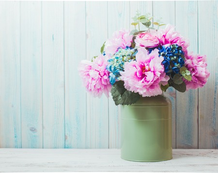 decors: flowers in can - rustic style, shabby chic Stock Photo