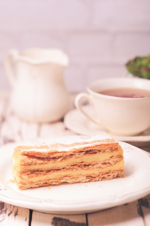 custard slices: Puff pastry dough with custard cream on a white plate