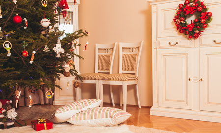 christmas gifts: Christmas tree with presents underneath  of Santa Claus and two pillows lying along