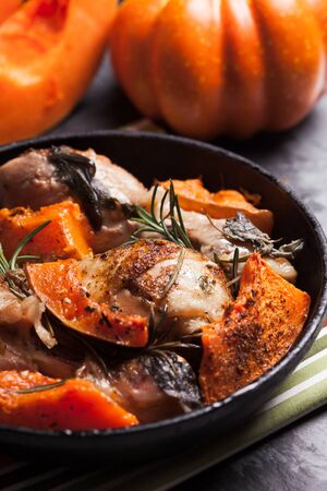 spicy food: Chicken with pumpkin baked in frying pan Stock Photo