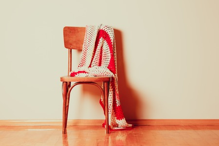 antique chair: Old chair with carelessly abandoned blanket on it
