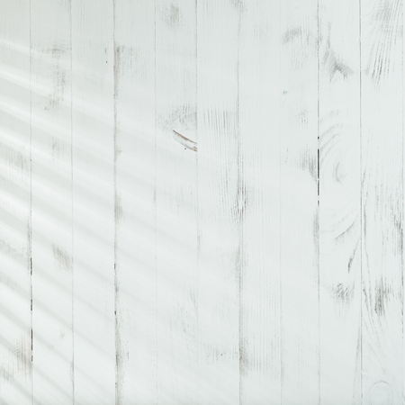 Venetian blinds sunlight on the shabby wooden wall