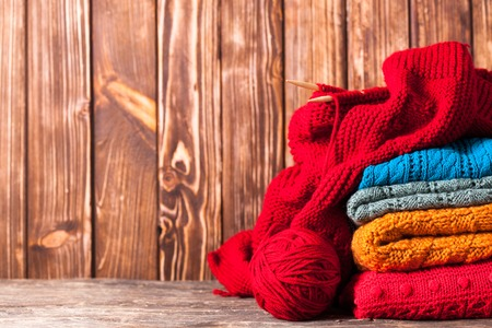 warm clothes: Color threads, knitting needles and clothes with copy space