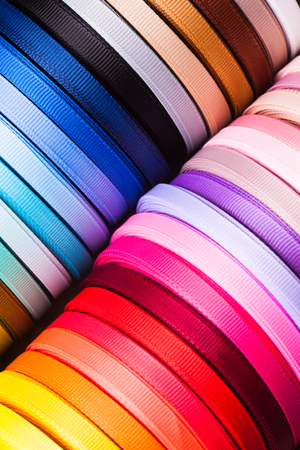 favours: The various colors ribbon bobbins close up