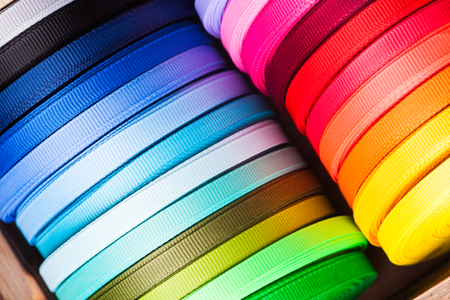 favours: The various colors ribbon bobbins close up