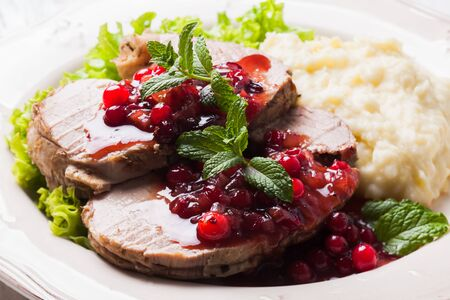 fillet steak: Beef with cranberry sauce and mashed potato Stock Photo