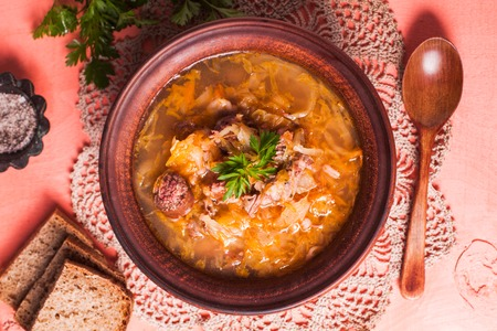 Gombaleves - Chrismtas hungarian soup with sauerkraut, sausages, mushrooms and barley Stock Photo