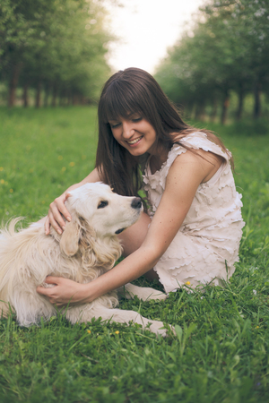 pillowy: Girl plays with golden retriever in the park