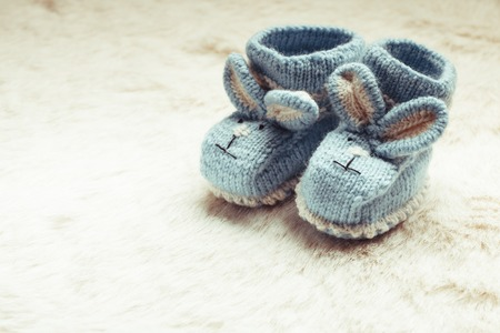 booties: Knitted blue baby booties with rabbit muzzle for little boy