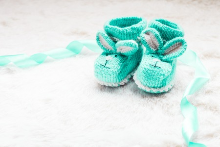 booties: Knitted green baby booties with rabbit muzzle for little boy