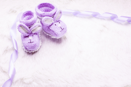cute babies: Knitted purple baby booties with rabbit muzzle over fur