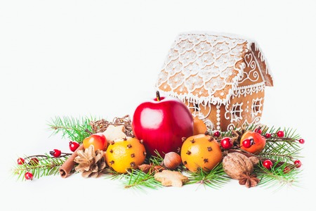 christmas house: gingerbread house with christmas decorations on a white backgrond
