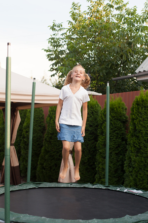 enthusiastically: Girl enthusiastically jumping on the trampoline. Moment flight